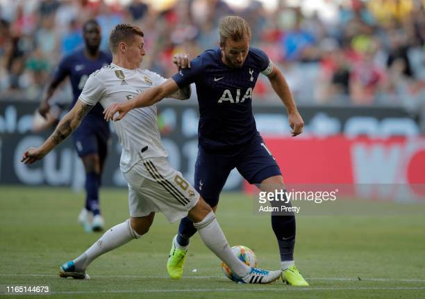 Toni Kroos of Madrid challenges Harry Kane of Tottenham during the Audi Cup 2019 semi final match between Real Madrid and Tottenham Hotspur at...