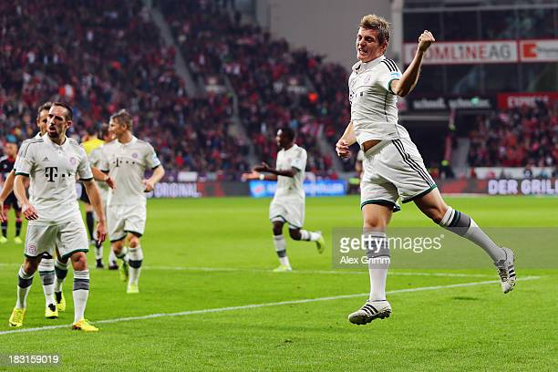 Toni Kroos of Muenchen celebrates his team's first goal during the Bundesliga match between Bayer Leverkusen and FC Bayern Muenchen at BayArena on...