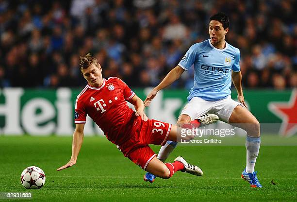 Toni Kroos of Muenchen is challenged by Samir Nasri of Manchester City during the UEFA Champions League Group D match between Manchester City and FC...
