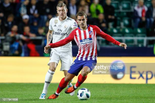 Toni Kroos of Real Madrid and Antoine Griezmann of Atletico Madrid in action during the UEFA Super Cup match between Real Madrid and Atletico Madrid...