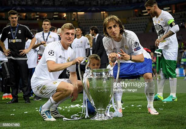 Toni Kroos of Real Madrid and Luka Modric of Real Madrid celebrate with the Champions League trophy after the UEFA Champions League Final match...