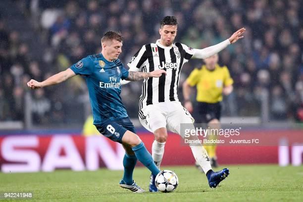 Toni Kroos of Real Madrid and Rodrigo Bentancur of Juventus in action during the UEFA Champions League Quarter Final Leg One match between Juventus...
