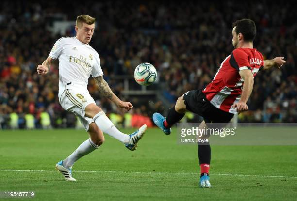 Toni Kroos of Real Madrid battles for possession with Inigo Lekue of Athletic Club during the Liga match between Real Madrid CF and Athletic Club at...