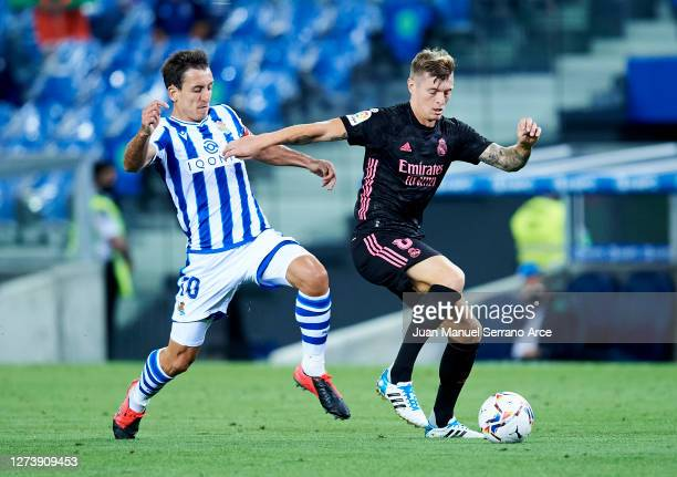 Toni Kroos of Real Madrid battles for possession with Mikel Oyarzabal of Real Sociedad during the La Liga Santander match between Real Sociedad and...