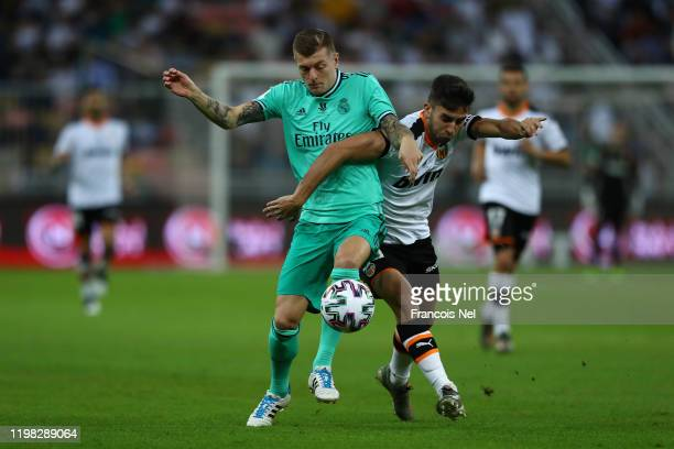 Toni Kroos of Real Madrid battles with Ferran Torres of Valencia during the Supercopa de Espana SemiFinal match between Valencia CF and Real Madrid...