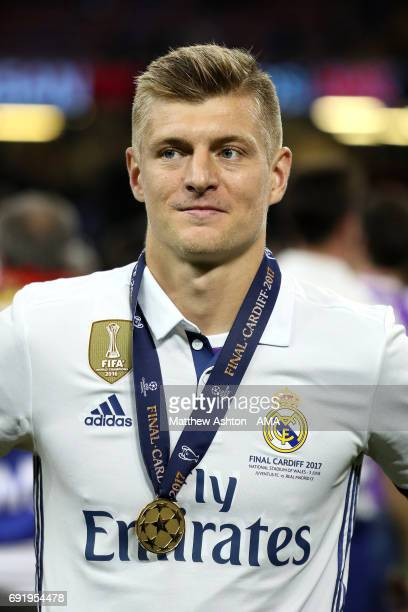 Toni Kroos of Real Madrid celebrates with his medal at the end of the UEFA Champions League Final between Juventus and Real Madrid at National...