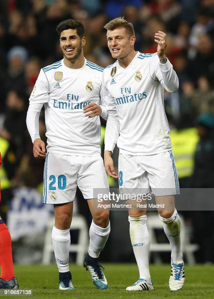 Toni Kroos of Real Madrid celebrates with Marco Asensio after scoring their team's third goal during the La Liga match between Real Madrid and Real...
