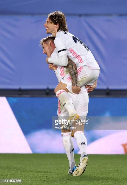 Toni Kroos of Real Madrid celebrates with team mate Luka Modric after scoring their side's second goal during the La Liga Santander match between...