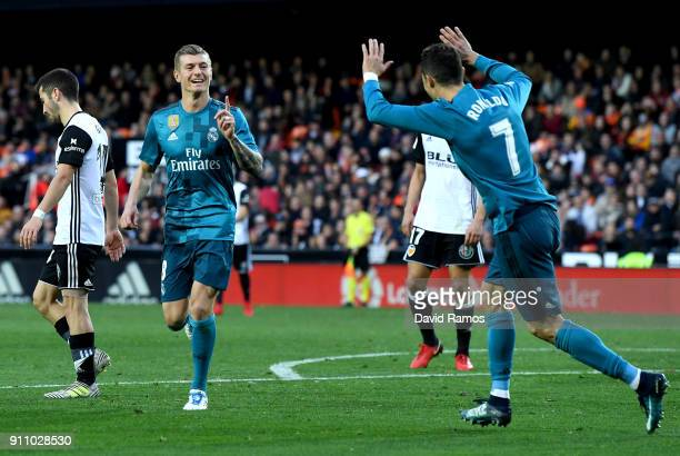 Toni Kroos of Real Madrid celebrates with teammate Cristiano Ronaldo after scoring his sides fourth goal during the La Liga match between Valencia...