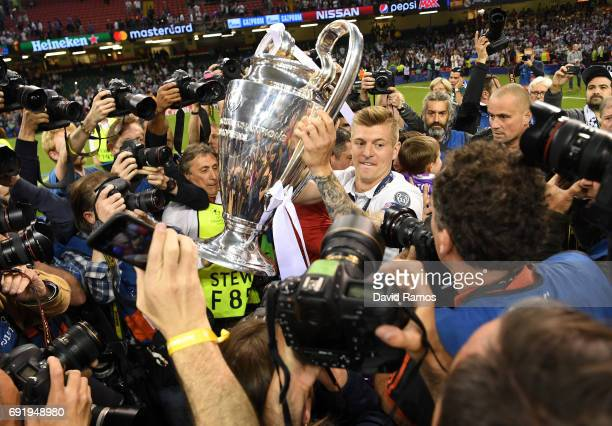 Toni Kroos of Real Madrid celebrates with The Champions League trophy during the UEFA Champions League Final between Juventus and Real Madrid at...