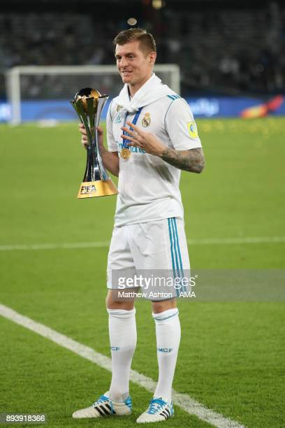 Toni Kroos of Real Madrid celebrates with the trophy at the end of the FIFA Club World Cup UAE 2017 final match between Gremio and Real Madrid CF at...
