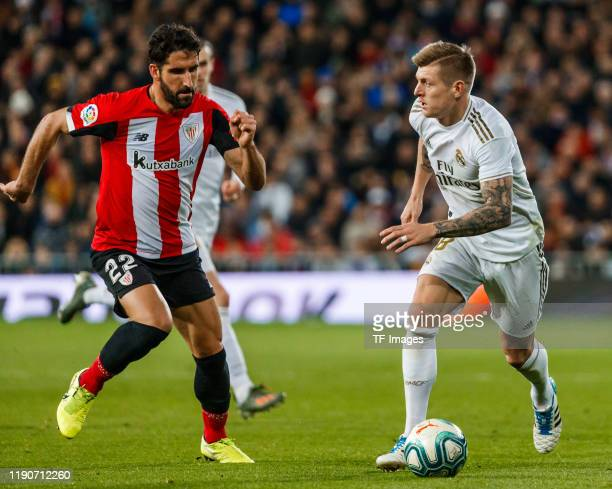 Toni Kroos of Real Madrid CF and Raúl García of Athletic Club Bilbao battle for the ball during the Liga match between Real Madrid CF and Athletic...