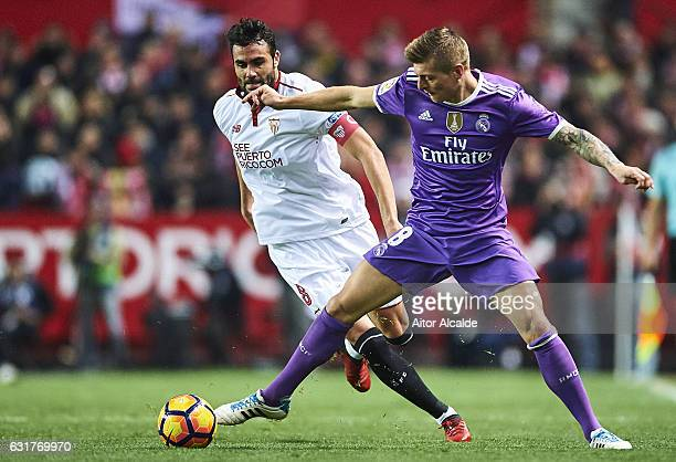 Toni Kroos of Real Madrid CF being followed by Vicente Iborra of Sevilla FC during the match against Real Madrid CF during the La Liga match between...