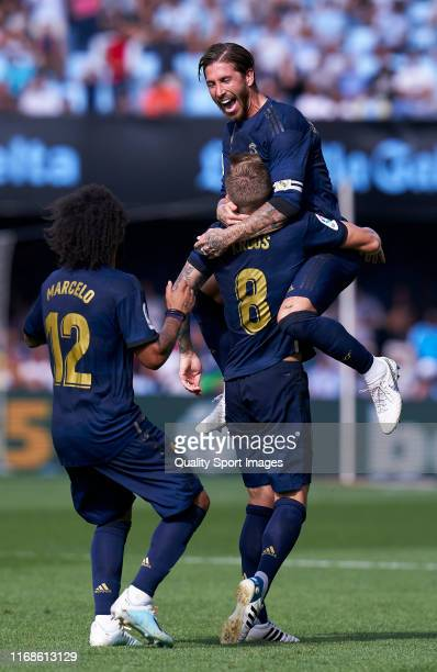 Toni Kroos of Real Madrid CF celebrates after scoring the second goal of his team with his team mates during the Liga match between RC Celta de Vigo...