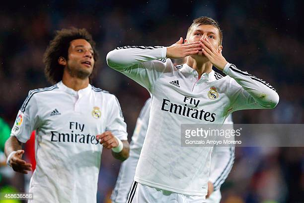 Toni Kroos of Real Madrid CF celebrates scoring their third goal during the La Liga match between Real Madrid CF and Rayo Vallecano de Madrid at...