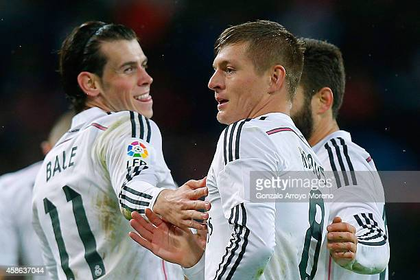 Toni Kroos of Real Madrid CF celebrates scoring their third goal with teammate Gareth Bale during the La Liga match between Real Madrid CF and Rayo...