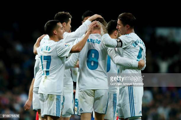 Toni Kroos of Real Madrid CF celebrates scoring their third goal with teammates during the La Liga match between Club Atletico Madrid and UD Las...