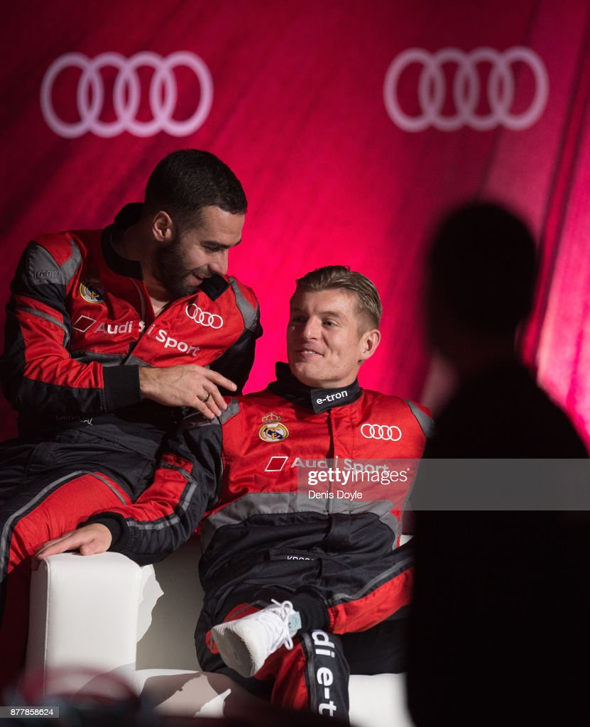 Toni Kroos of Real Madrid CF chats with his teammate Dani Carvajal after their simulated Formula e car race during the Audi Handover Sponsorship deal with Real Madrid at the Ciudad Deportivo training grounds on November 23, 2017 in Madrid, Spain.