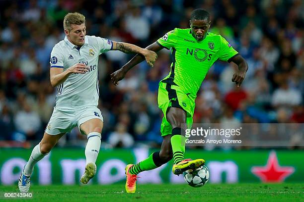 Toni Kroos of Real Madrid CF competes for the ball with William Carvalho of Sporting CP during the UEFA Champions League group stage match between...