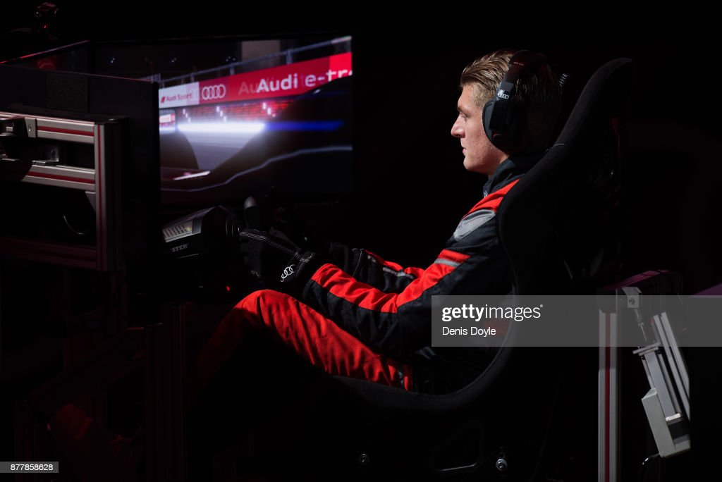 Toni Kroos of Real Madrid CF in action in his simulated car during a race with his teammates during the Audi Handover Sponsorship deal with Real Madrid at the Ciudad Deportivo training grounds on November 23, 2017 in Madrid, Spain.