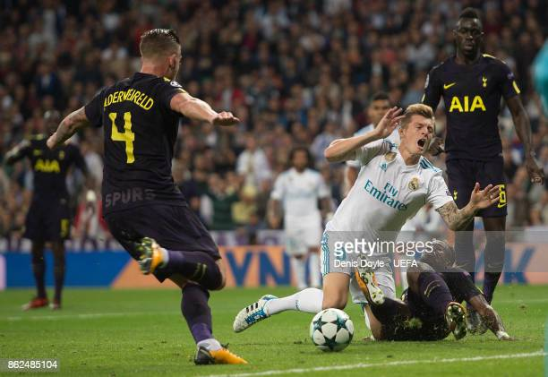 Toni Kroos of Real Madrid CF is brought down by Serge Aurier of Tottenham for a penalty kick during the UEFA Champions League group H match between...