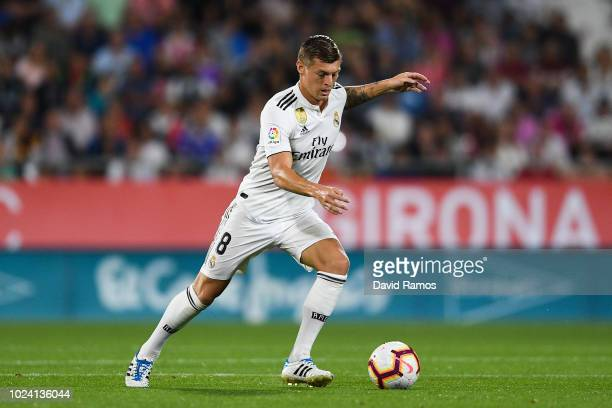 Toni Kroos of Real Madrid CF runs with the ball during the La Liga match between Girona FC and Real Madrid CF at Montilivi Stadium on August 26 2018...