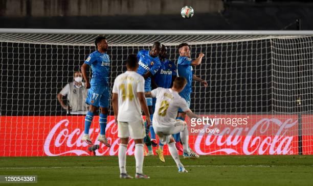Toni Kroos of Real Madrid CF takes a free kick during the Liga match between Real Madrid CF and Valencia CF at Estadio Alfredo Di Stefano on June 18,...