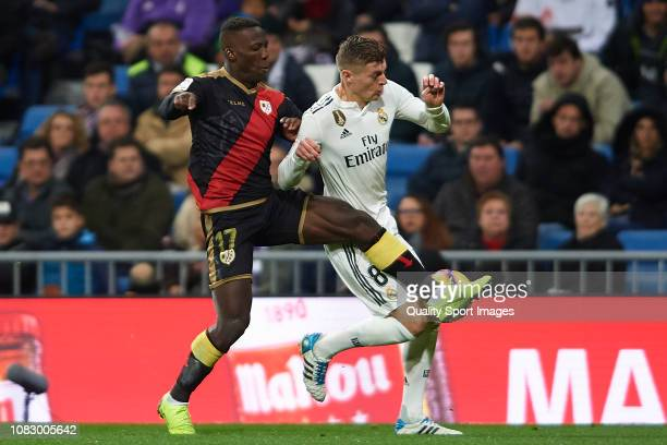 Toni Kroos of Real Madrid competes for the ball with Advincula of Rayo Vallecano during the La Liga match between Real Madrid CF and Rayo Vallecano...