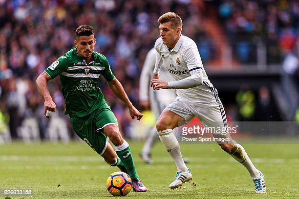 Toni Kroos of Real Madrid competes for the ball with Gabriel Appelt Pires of Deportivo Leganes during their La Liga match between Real Madrid and...