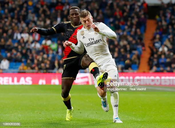 Toni Kroos of Real Madrid competes for the ball with Luis Advincula of Rayo Vallecano during the La Liga match between Real Madrid CF and Rayo...