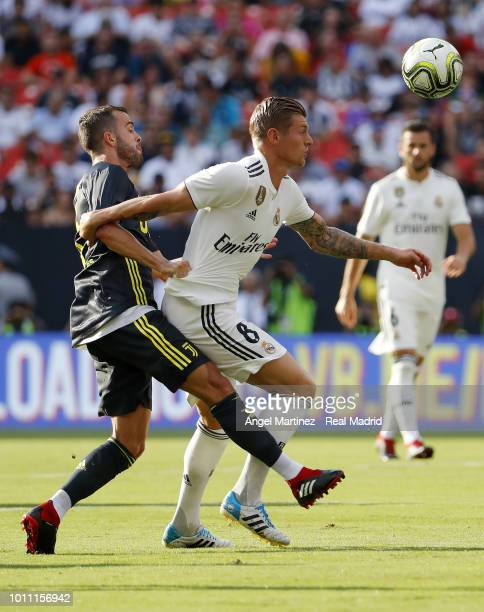 Toni Kroos of Real Madrid competes for the ball with Miralem Pjanic of Juventus during the International Champions Cup 2018 match between Real Madrid...