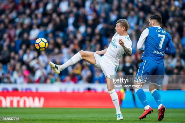 Toni Kroos of Real Madrid fights for the ball with Lucas Perez Martinez of RC Deportivo La Coruna during the La Liga 201718 match between Real Madrid...