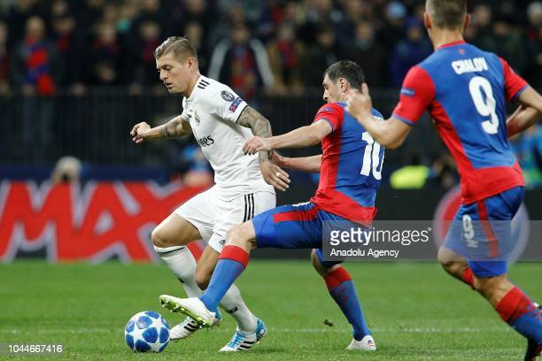 Toni Kroos of Real Madrid in action against Alan Dzagoev of CSKA Moscow during UEFA Champions League Group G soccer match between CSKA Moscow and...
