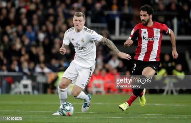 Toni Kroos of Real Madrid in action against Raul Garcia of Athletic de Bilbao during the La Liga match between Real Madrid and Athletic de Bilbao at...