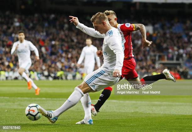 Toni Kroos of Real Madrid in action during the La Liga match between Real Madrid and Girona at Estadio Santiago Bernabeu on March 18 2018 in Madrid...
