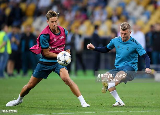 Toni Kroos of Real Madrid is blocked by team mate Marcos Llorente during a Real Madrid training session ahead of the UEFA Champions League Final...