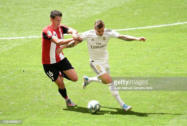Toni Kroos of Real Madrid is challenged by Mikel Vesga of Athletic Club during the La Liga match between Athletic Club and Real Madrid CF at San...