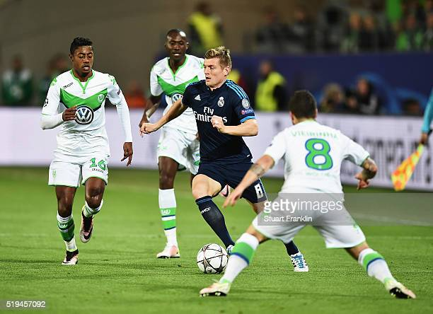 Toni Kroos of Real Madrid is challenged by Vieirinha of Wolfsburg during the UEFA Champions League Quarter Final First Leg match between VfL...