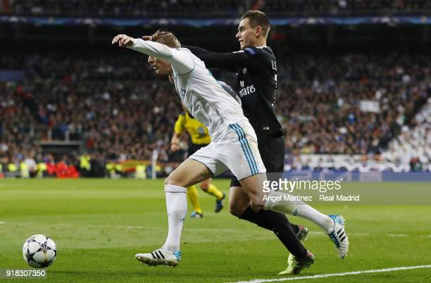 Toni Kroos of Real Madrid is fouled in the penalty area by Giovani Lo Celso of Paris SaintGermain during the UEFA Champions League Round of 16 First...