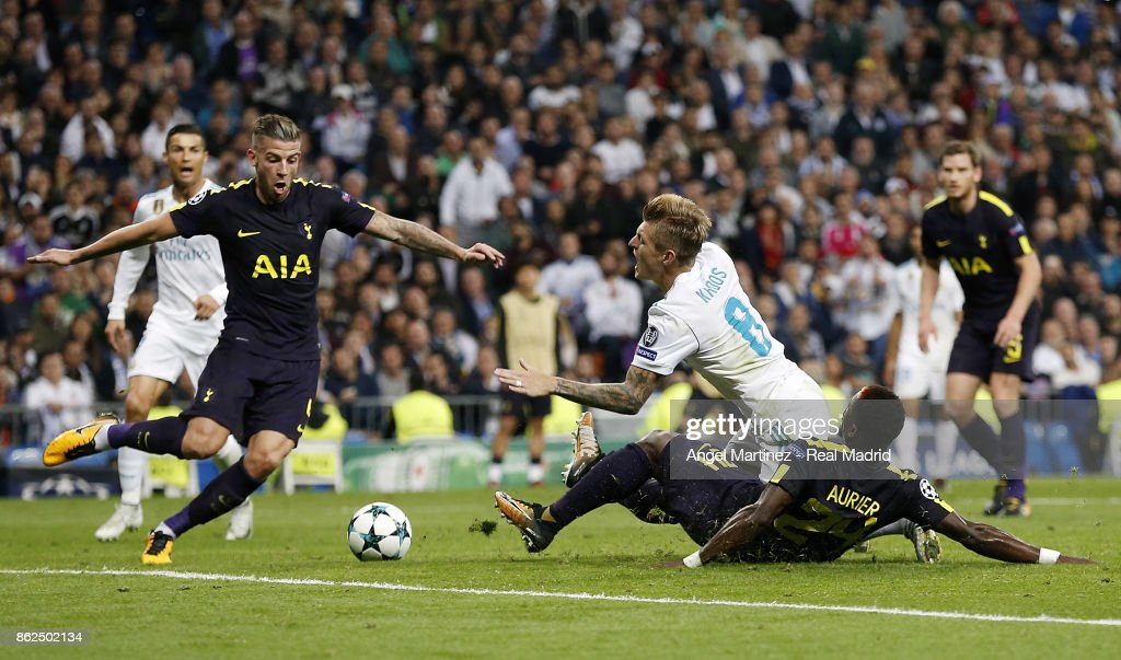 Toni Kroos of Real Madrid is tackled in penalty area by Serge Aurier of Tottenham Hotspur during the UEFA Champions League group H match between Real Madrid CF and Tottenham Hotspur at Estadio Santiago Bernabeu on October 17, 2017 in Madrid, Spain.