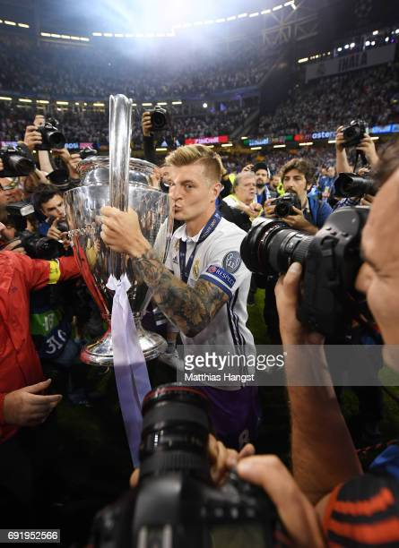 Toni Kroos of Real Madrid kisses the Champions League trophy after the UEFA Champions League Final between Juventus and Real Madrid at National...