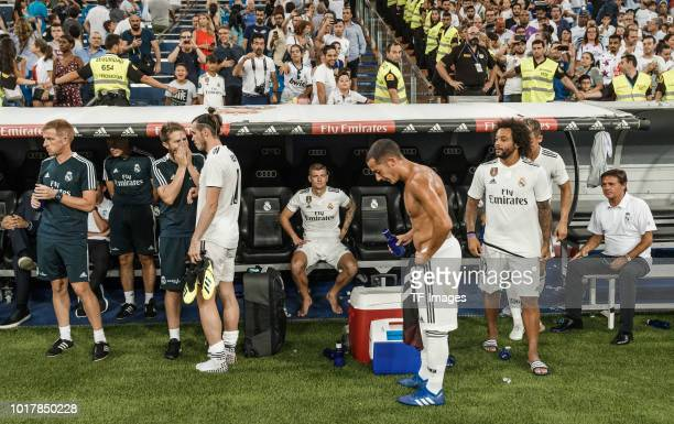 Toni Kroos of Real Madrid Lucas Vazquez of Real Madrid Marcelo of Real Madrid and Gareth Bale of Real Madrid look on after the Santiago Bernabeu...