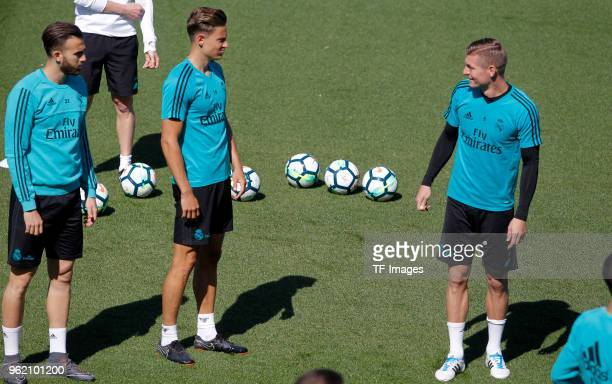 Toni Kroos of Real Madrid Marcos Llorente of Real Madrid and Borja Mayoral of Real Madrid look on during a training session at Valdebebas training...