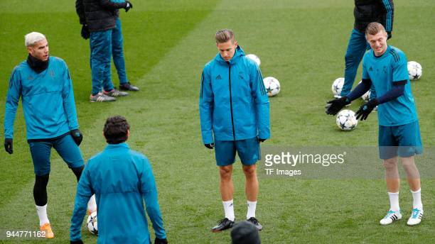 Toni Kroos of Real Madrid Marcos Llorente of Real Madrid and Theo Hernandez of Real Madrid look on during a training session at Valdebebas training...