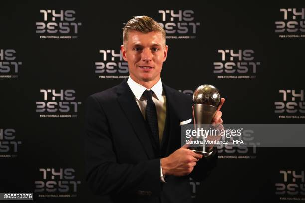 Toni Kroos of Real Madrid poses with his FIFA FIFPro World 11 award after being included in the team of the year after The Best FIFA Football Awards...