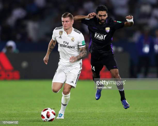 Toni Kroos of Real Madrid runs with the ball under pressure from Hussein El Shahat of Al Ain during the FIFA Club World Cup UAE 2018 Final between Al...