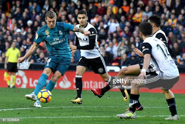 Toni Kroos of Real Madrid scores his side's fourth goal during the La Liga match between Valencia and Real Madrid at Estadio Mestalla on January 27...