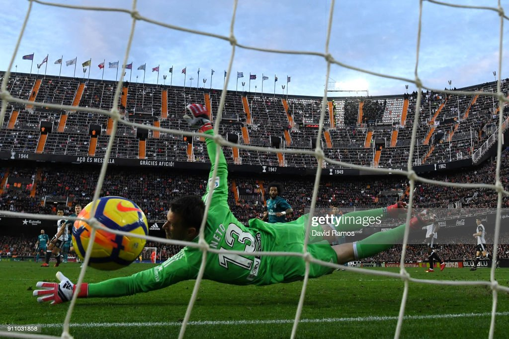 Toni Kroos of Real Madrid (not pictured) scores his side's fourth goal past Norberto Neto of Valencia during the La Liga match between Valencia and Real Madrid at Estadio Mestalla on January 27, 2018 in Valencia, Spain.