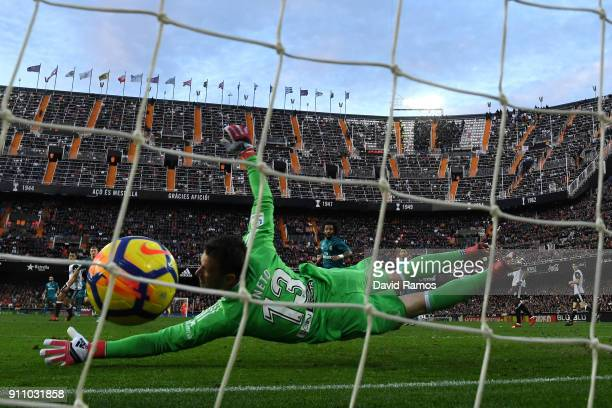 Toni Kroos of Real Madrid scores his side's fourth goal past Norberto Neto of Valencia during the La Liga match between Valencia and Real Madrid at...