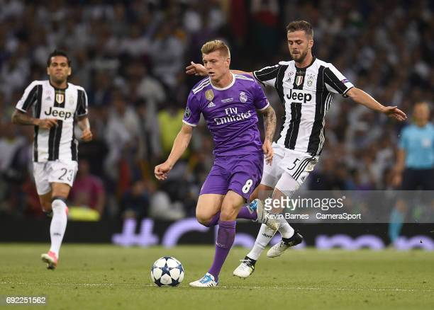 Toni Kroos of Real Madrid under pressure from Miralem Pjanic of Juventus during the UEFA Champions League Final match between Juventus and Real...